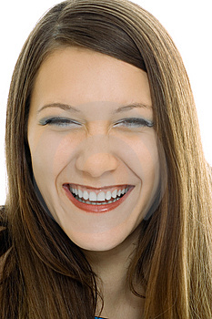 Stock Images - Young beauty brunette girl laughing