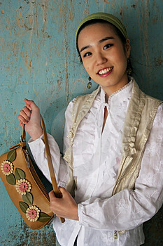 Free Stock Images - Asian woman holding a handbag