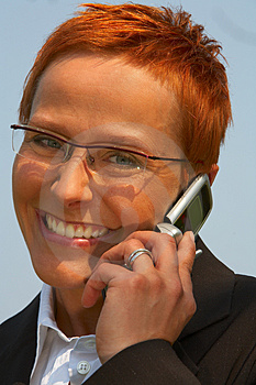 Stock Photo - Business woman making a phone call.