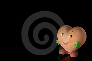Stock Photos - Smiling heart-shaped doll