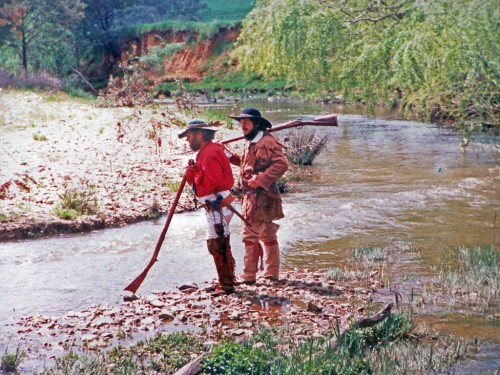 Old Injun and Glen Mitchell checking the creek banks for sign.