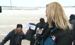 TV news reporters clowning around before their report
