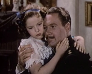 Shirley Temple hugging her on-screen dad
