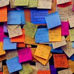 A wall of multi-colored sticky notes