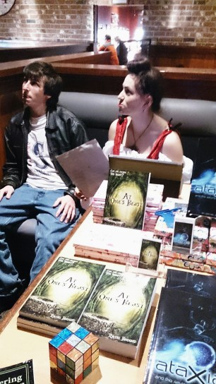 Rachel Barnard with her brother and her books
