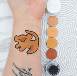She used Colourpop shadows to create Simba on her arm. Check out her Instagram for more Disney themed looks. (Photo by Chelsea Clement)