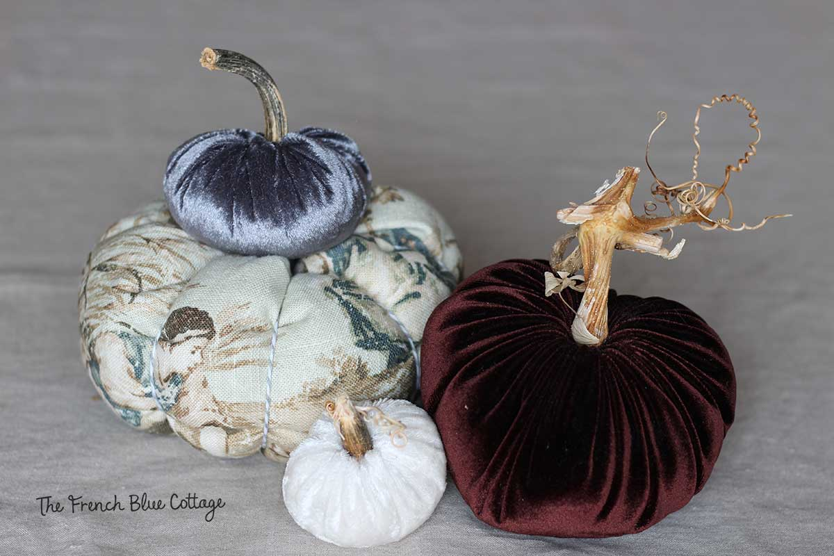 Velvet and fabric pumpkins with real stems.