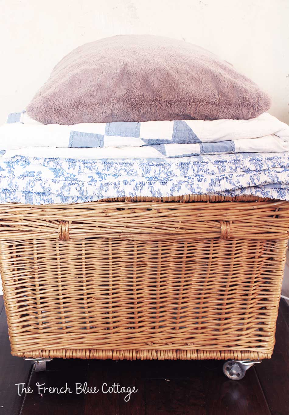 Cozy stack of blankets and quilts.