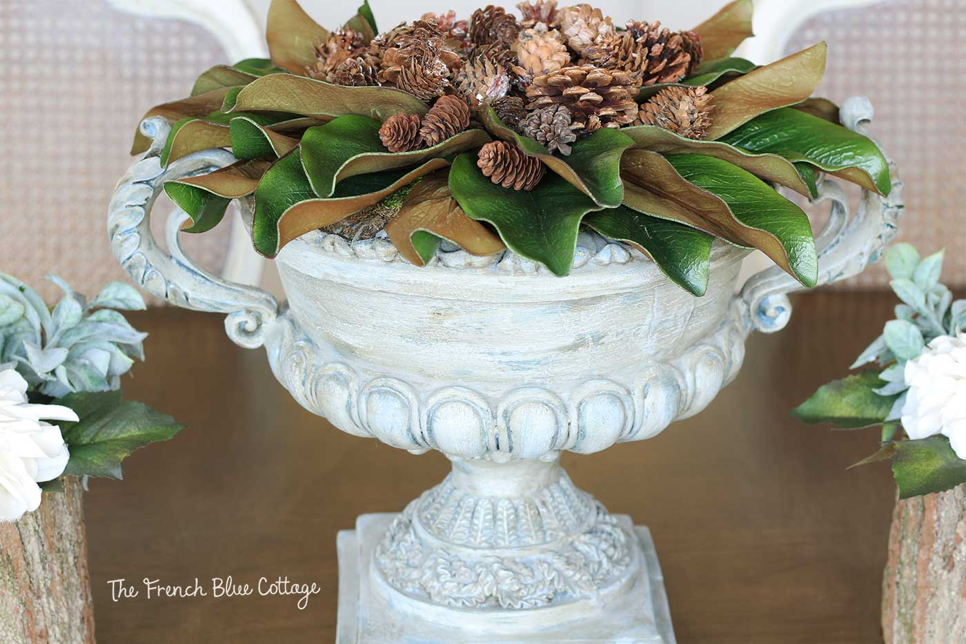Winter urn with magnolia leaves and pinecones.