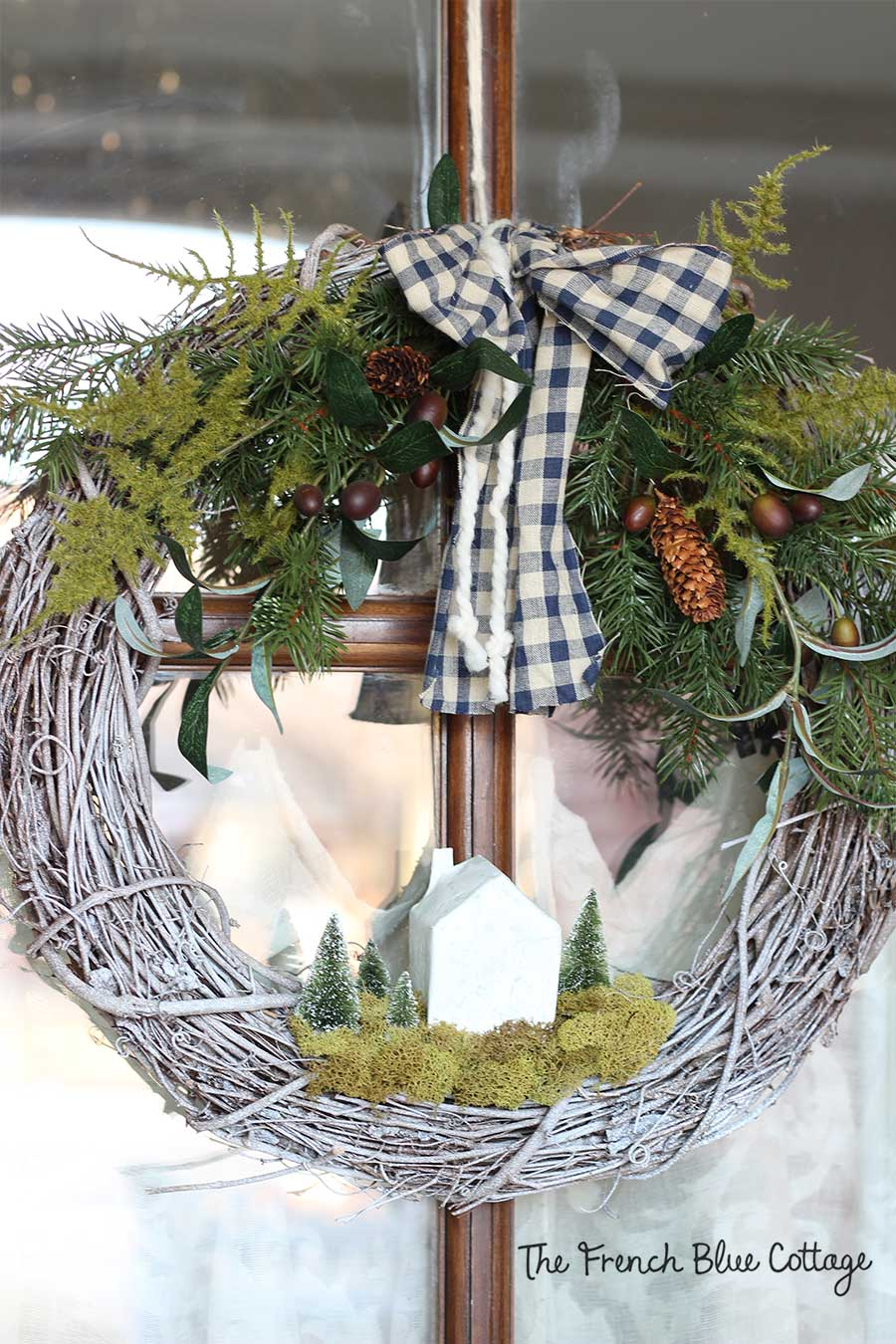 Gingham and yarn bow on winter wreath.