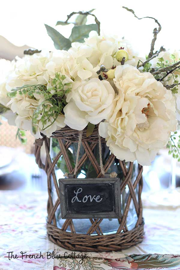 Valentine's bouquet centerpiece with faux white flowers.