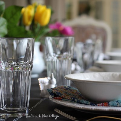 Colorful Easter tablescape with black paper and a chalk pen.