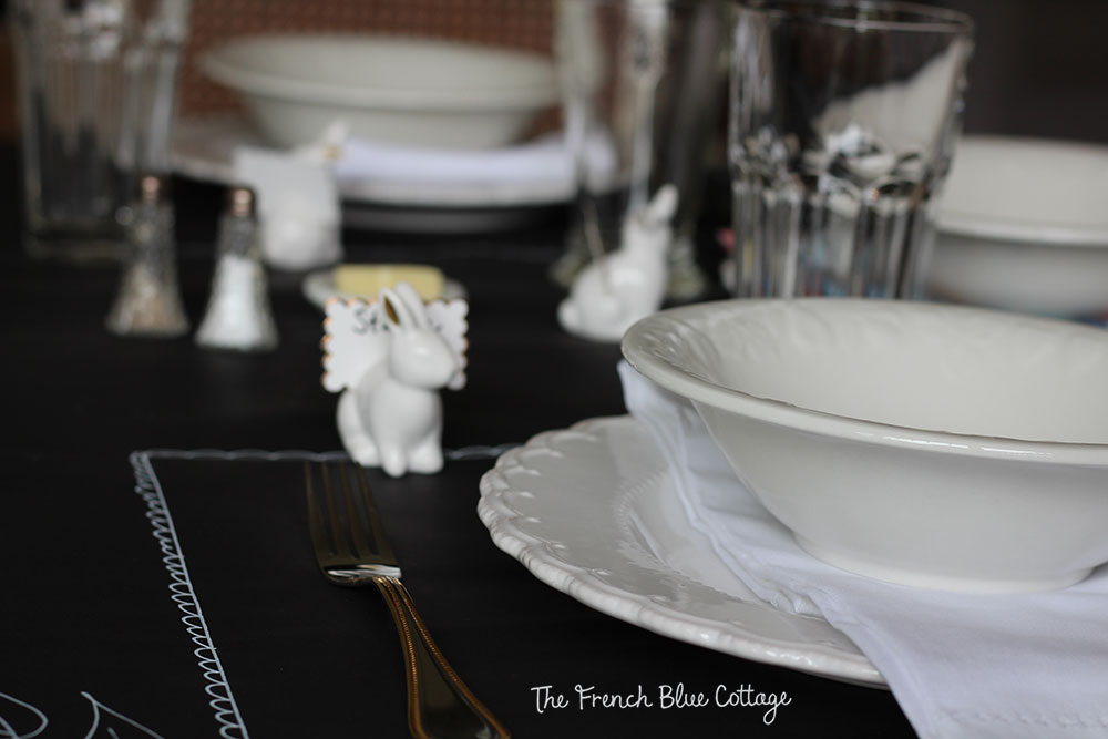 Lay black paper as a tablecloth and draw fancy placemats around your dishes with a white chalk pen.