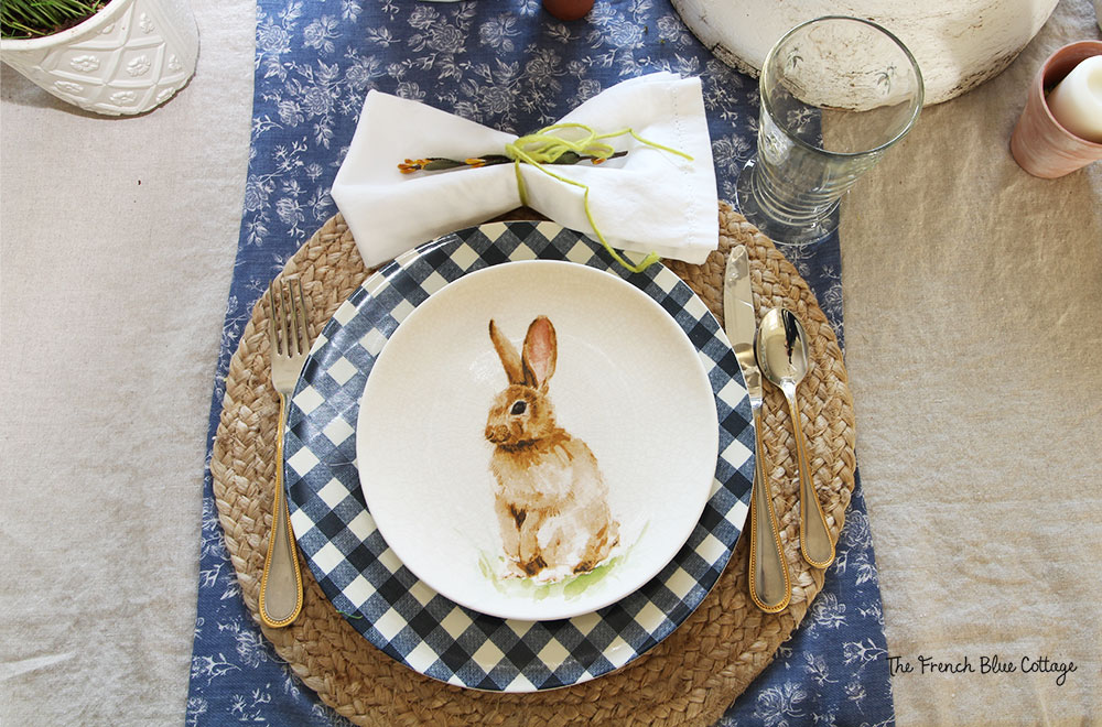 Bunny and gingham place setting with a woven placemat.
