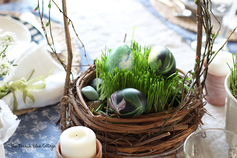 Real grass planted in a basket for Easter with hand painted eggs.
