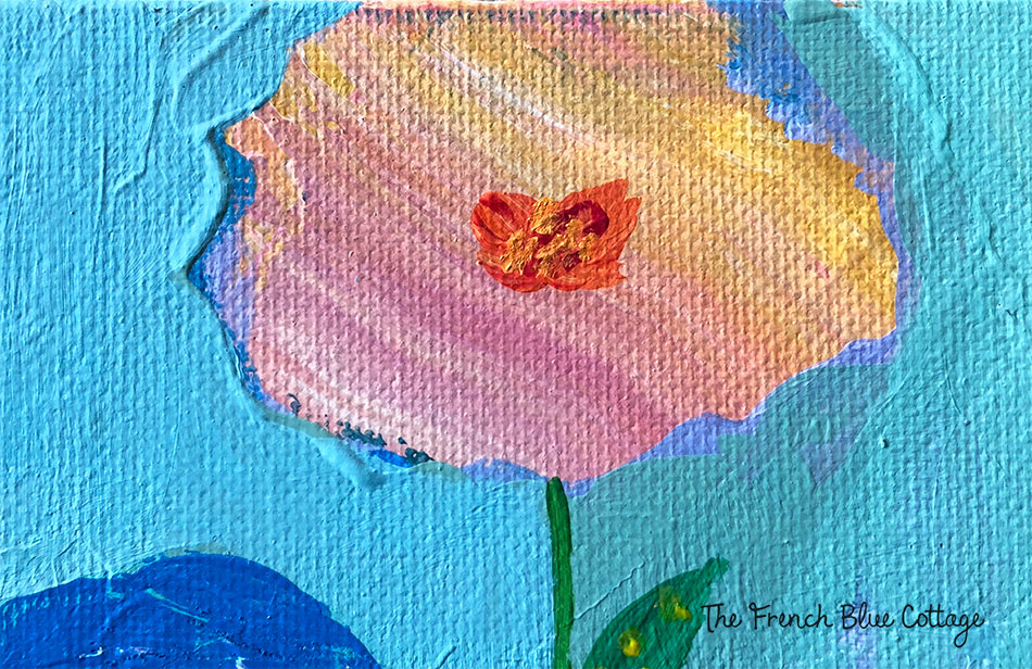 Make layers of paint and then turn them into flowers.