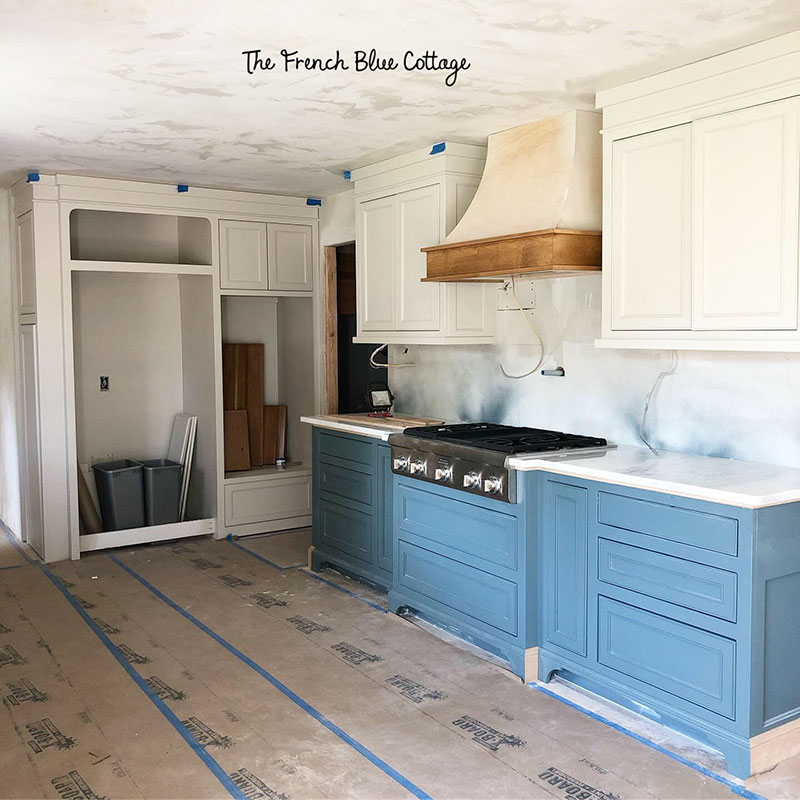french country kitchen with two tone painted cabinets