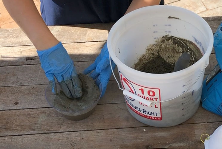placing concrete in a bowl to make a jewelry holder