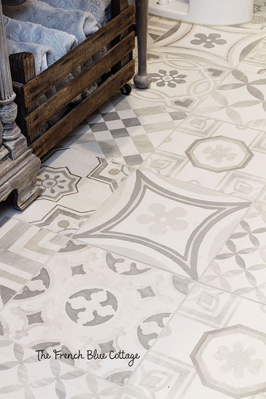 gray and white bathroom tile floor with patchwork style tiles