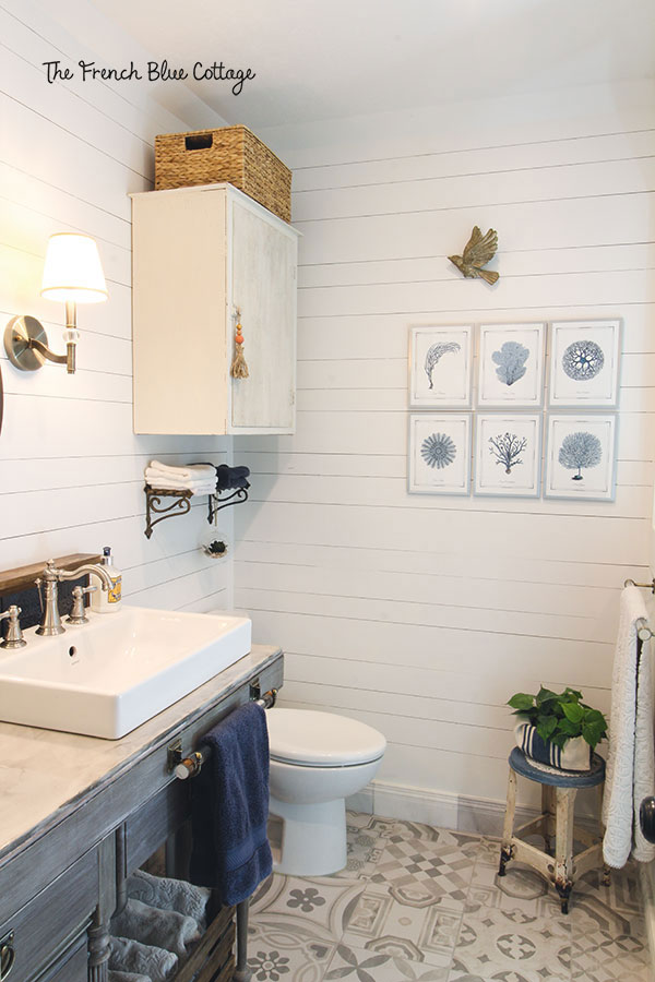 shiplap bathroom walls with sea fan art