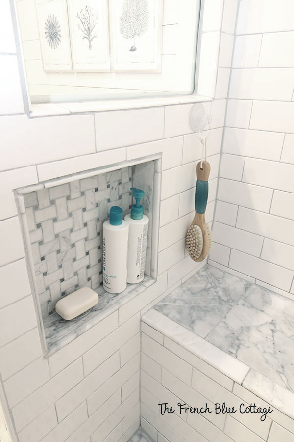built-in shower niche for shampoo bottles and soap