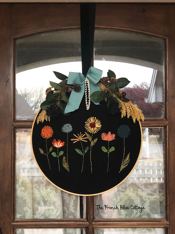 embroidery hoop wreath on a fall front porch