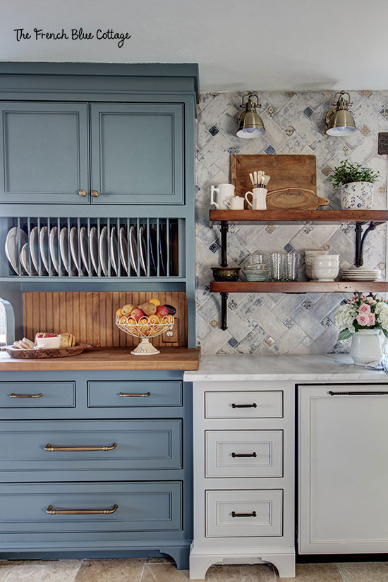 blue hutch in kitchen with plate rack and butcher block