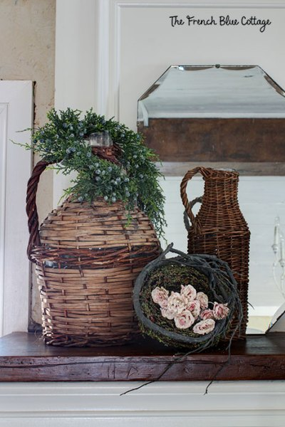 two wicker jars and a nest with pink flowers