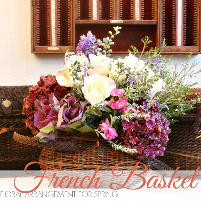 FLORAL ARRANGEMENT FOR SPRING IN AN ANTIQUE BASKET