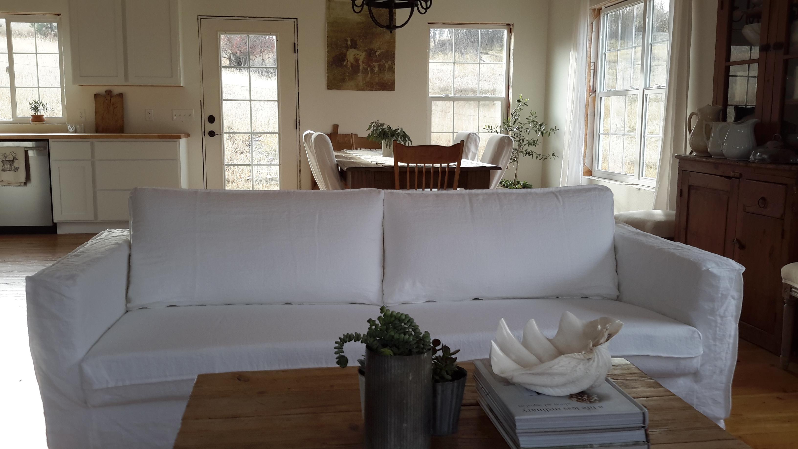 linen slipcovered sofa foam fold out bed uk white slipcover energywarden