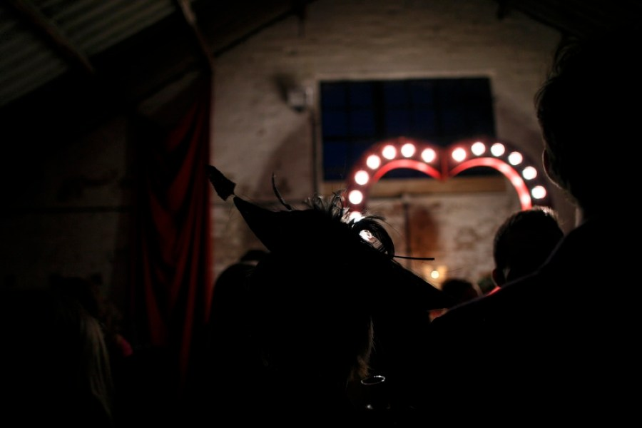 english-barn-wedding-with-curtains-and-a-giant-light-heart-25