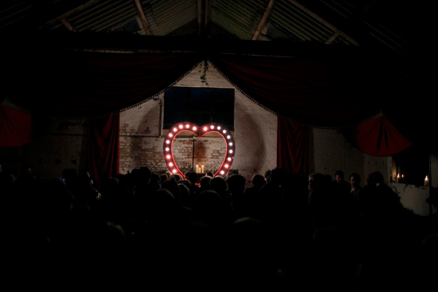 english-barn-wedding-with-curtains-and-a-giant-light-heart-28