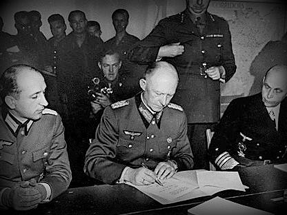 German Marshal Alfred Jodl signing the surrender of German armies in Reims on the 7th May 1945.