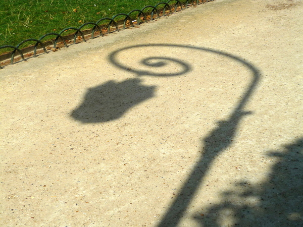 Shadow of lamp post in Place des Vosges © French Moments