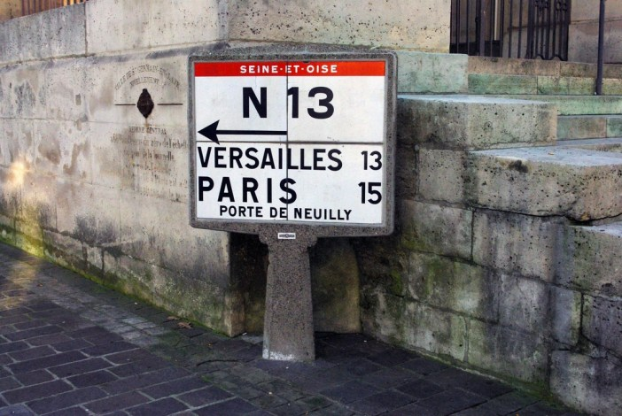 Vintage road sign by the church © French Moments