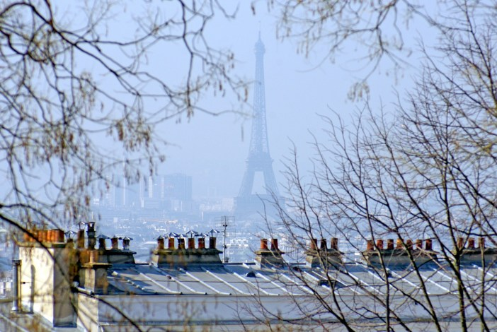 The Eiffel Tower seen from afar on a Sunny day in Montmartre © French Moments