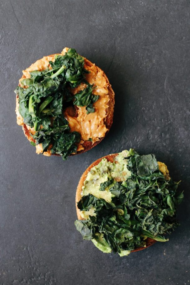 Crispy Kale Bagel Sandwiches. An easy, #vegan and #vegetarian breakfast idea: layer crispy kale on top of salted avocado and peanut butter.
