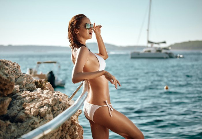 Girl in bikini with yacht