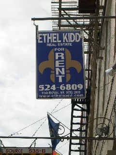"""The Fleur de Lis in Advertising in a French Town Back to our documentary on the varied forms that the Fleur de Lis takes in New Orleans graphics. This one is split down the middle to accomodate the """"For Rent"""" ad and sign text."""