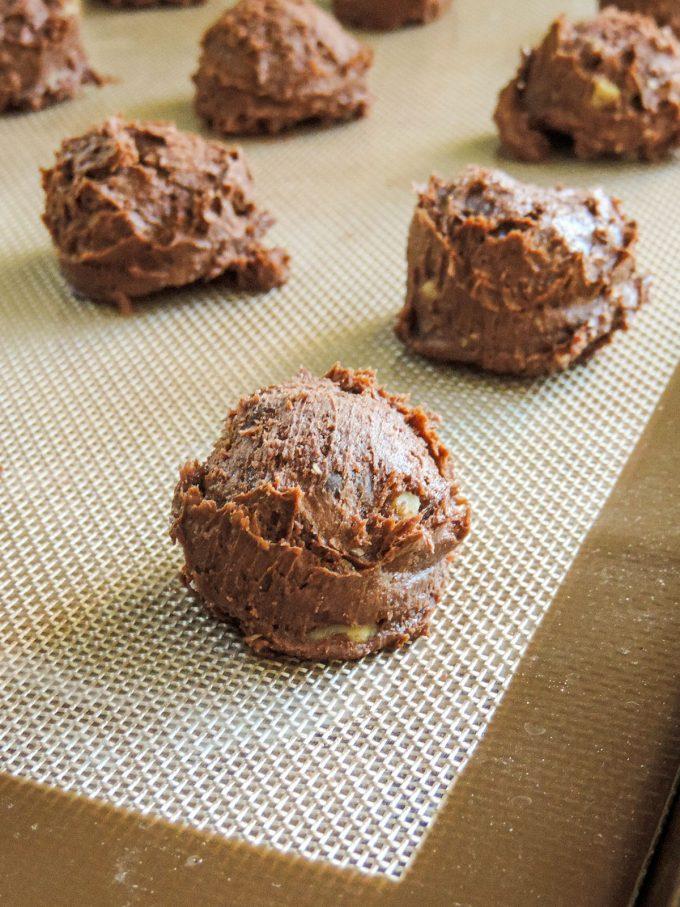 brownie cookie dough balls on a baking sheet