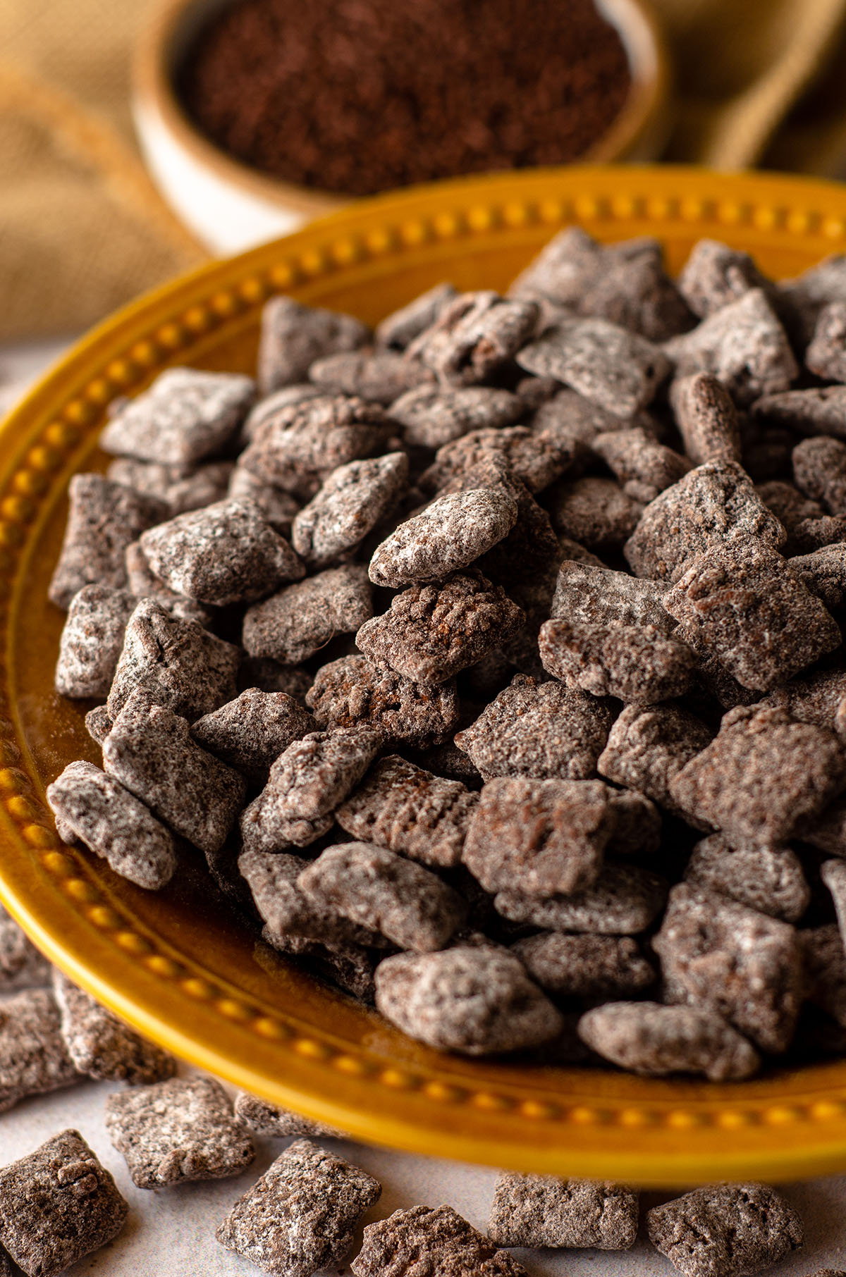 brownie batter puppy chow in a golden yellow bowl