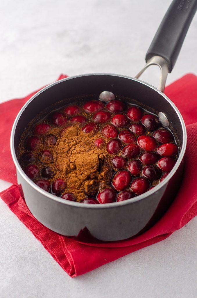 cranberries and cinnamon in a saucepan