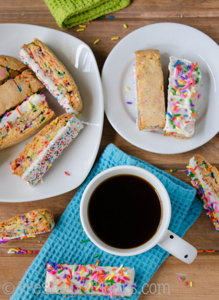 Funfetti Biscotti: Crunchy biscotti filled with sprinkles and dipped in white chocolate, perfect for dunking in coffee. A party in your mouth and your mug!