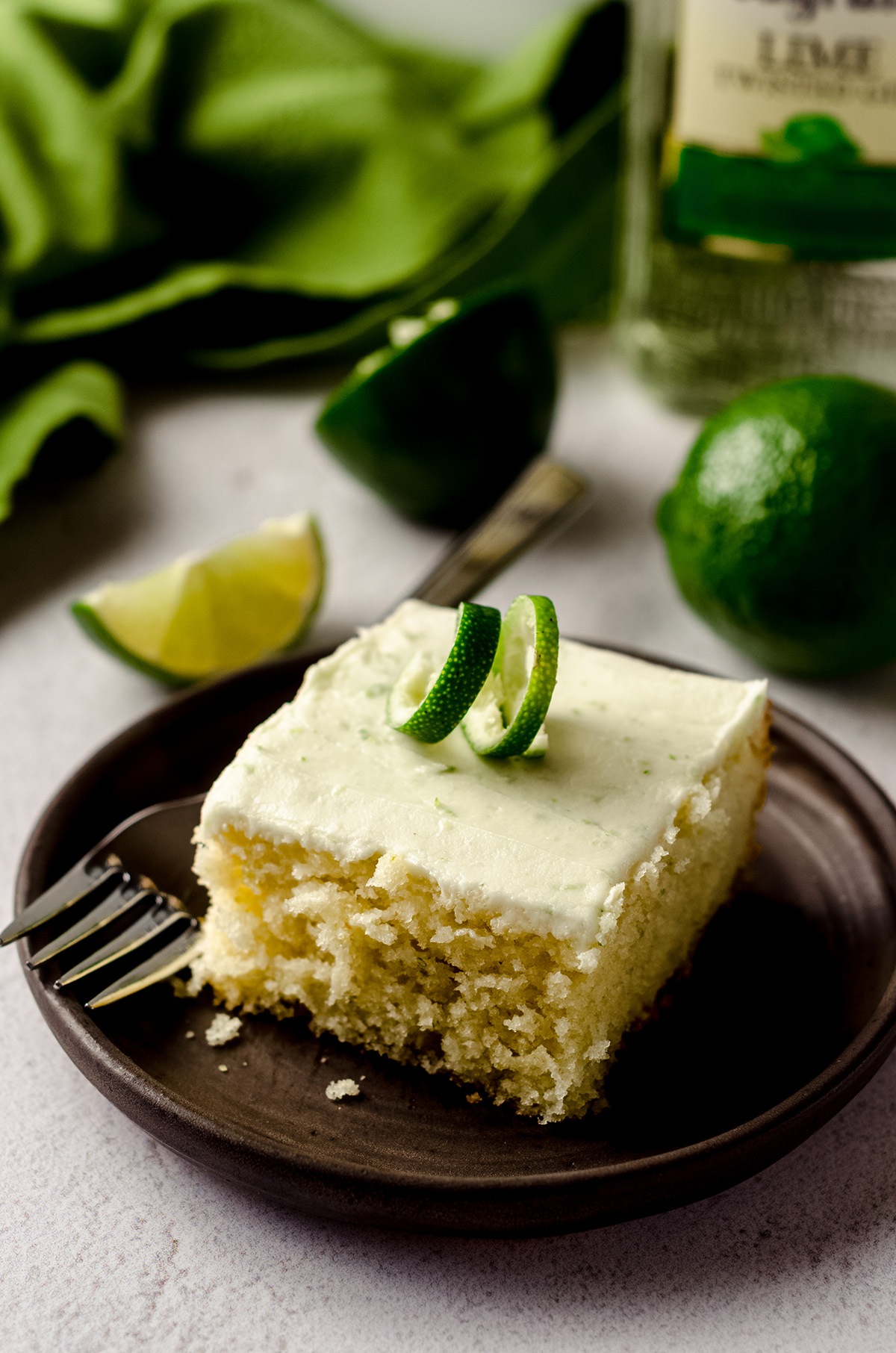 slice of gin and tonic cake sitting on a plate