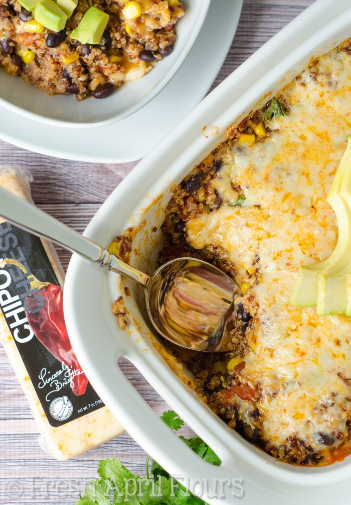 Cheesy Enchilada Quinoa Casserole: A quick, healthy, and gluten free enchilada casserole full of spicy flavors, lots of cheese, and nutrient-rich quinoa.