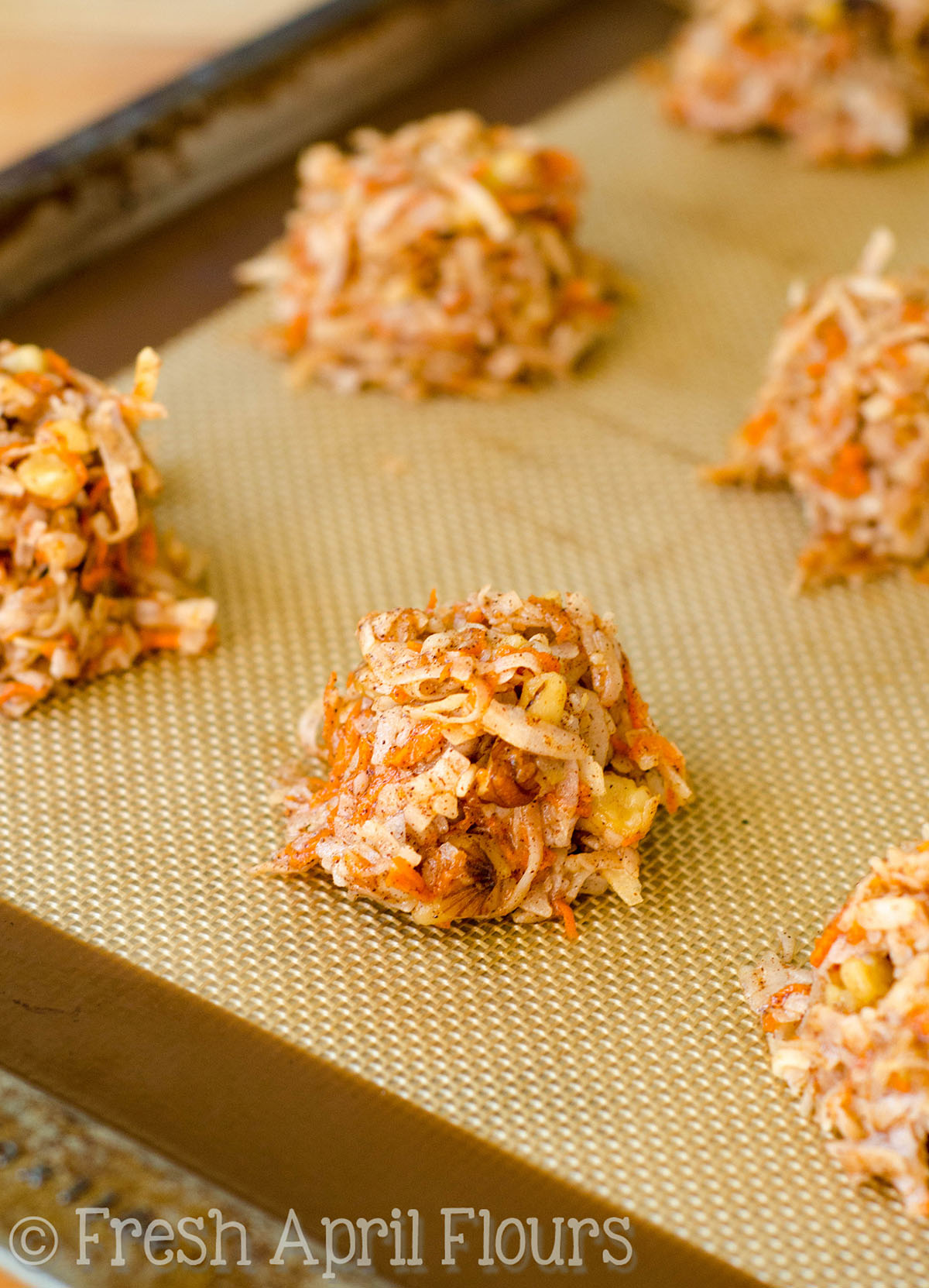 carrot cake coconut macaroons on a baking sheet