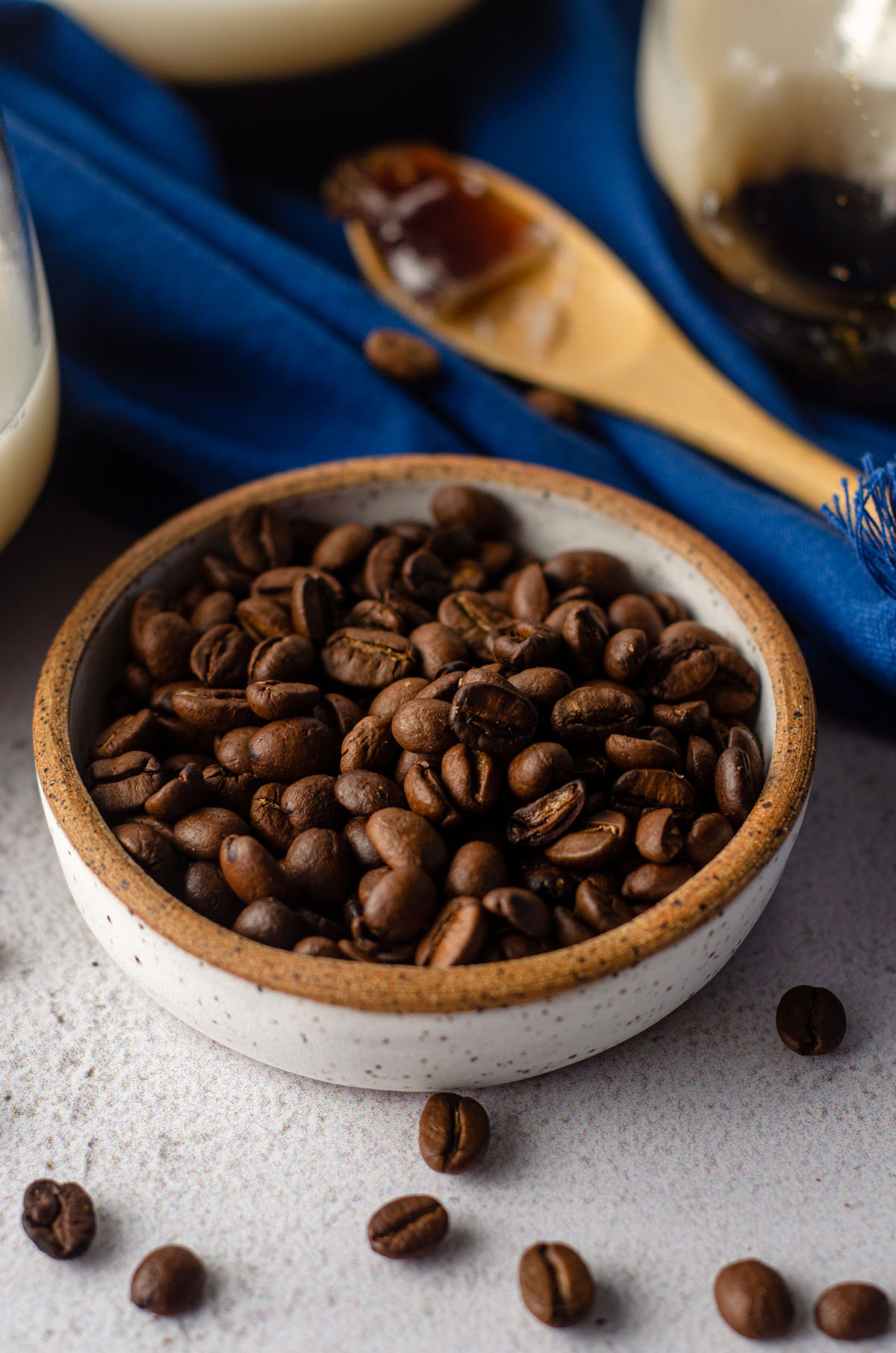 small pottery bowl of coffee beans