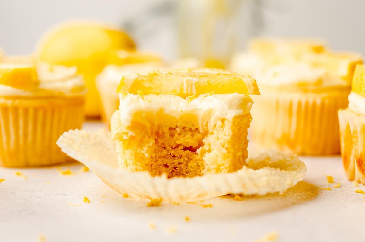 triple lemon cupcake with a bite taken out of it
