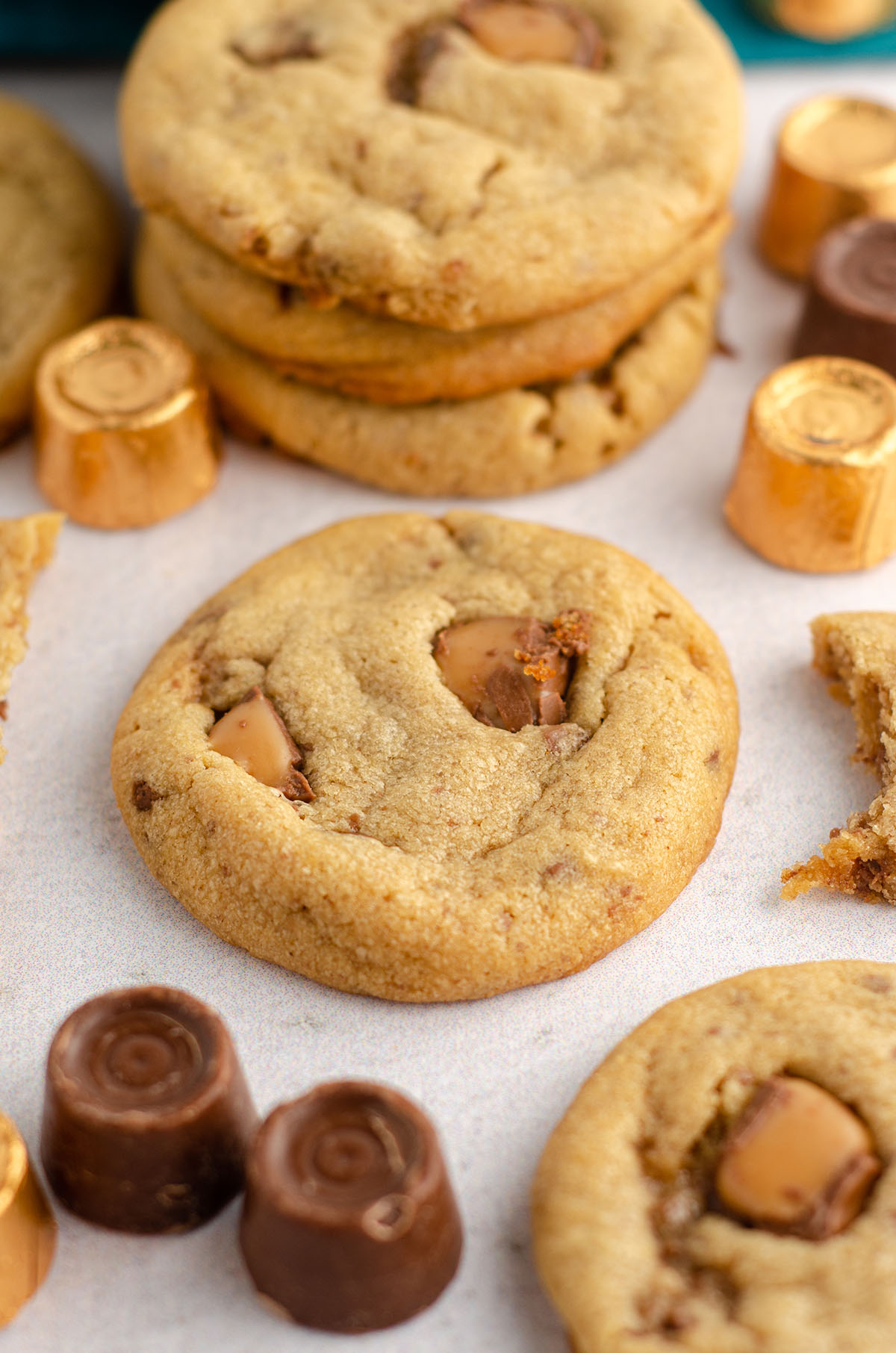 peanut butter rolo cookies surrounded by rolos