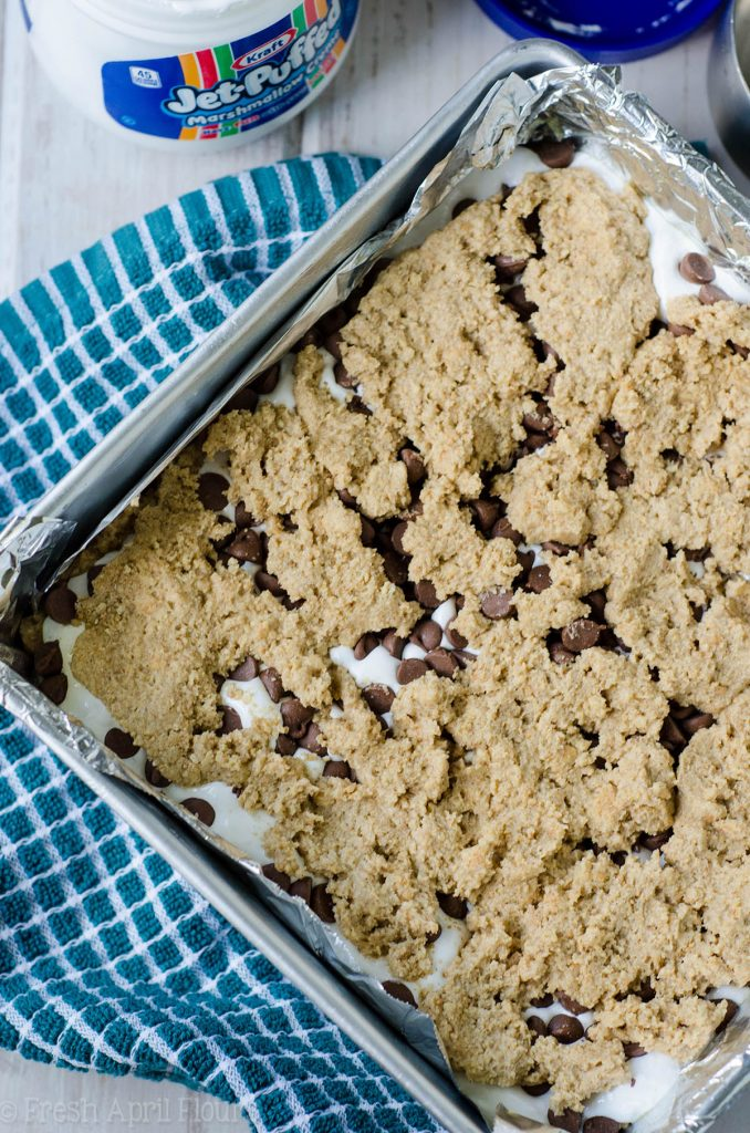 S'mores Chewy Cookie Bars: Soft and chewy graham cookie bars filled with a fluffy layer of marshmallow creme and milk chocolate chips. All the s'more without the flame!